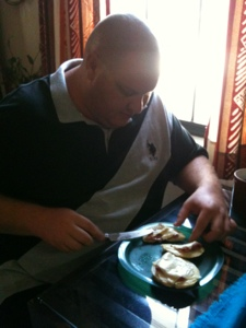 Shawn eating his bagel melt... and sharing 1/2 with me.